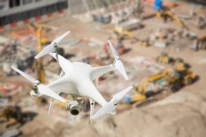 UAV quadcopter flying over a construction site in order to film a documentary of a construction company