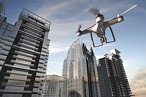 UAV equipped with drone insurance flying through highrise buildings in order to capture city life for an upcoming documentary