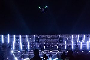 drone that is covered by drone insurance being used in a light show for a concert